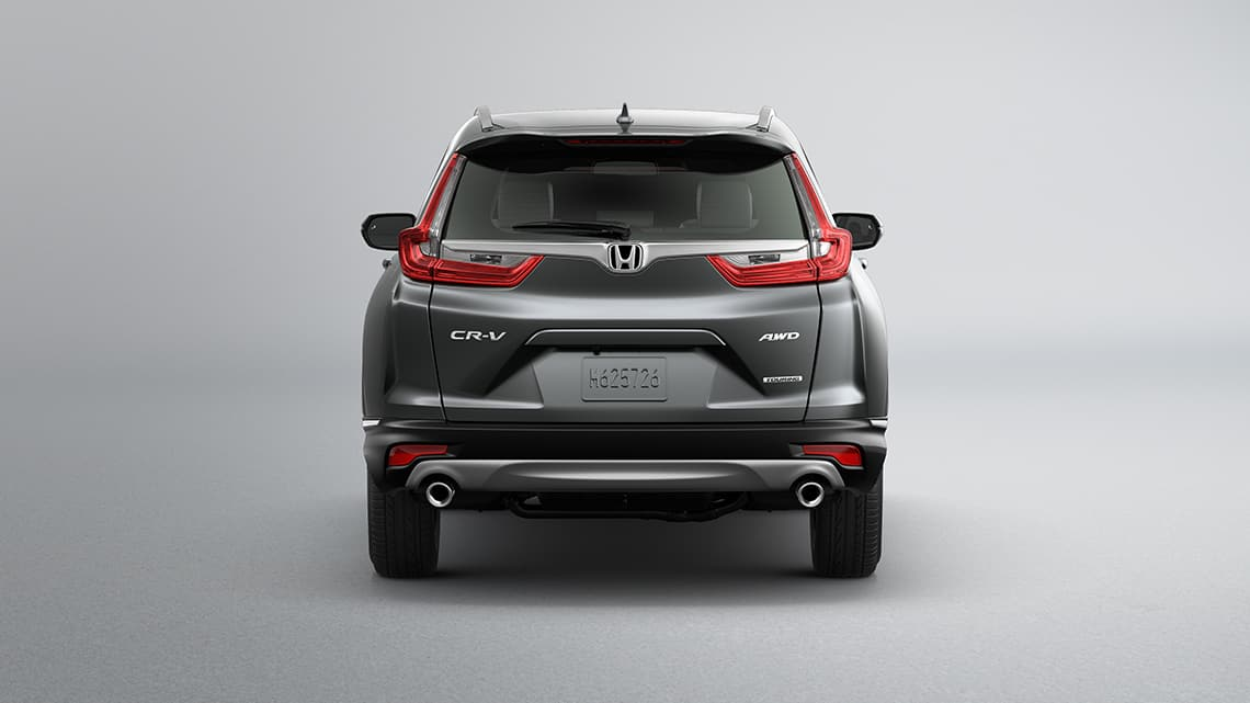 Rear view of 2019 Honda CR-V Touring in Gunmetal Metallic showing dual chrome exhaust finishers.