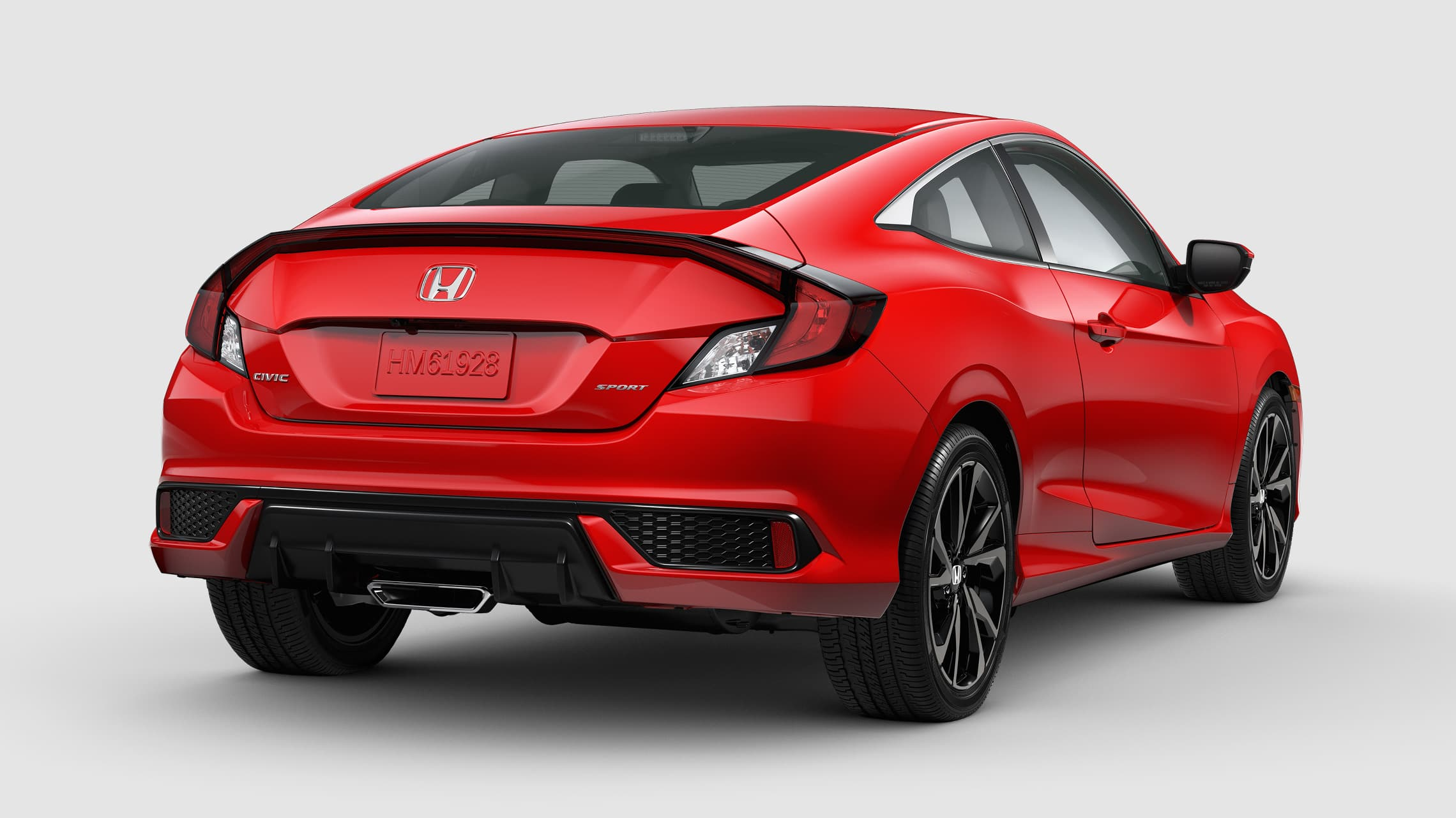 Vista trasera del Honda Civic Sport Coupé 2020 en Rallye Red.