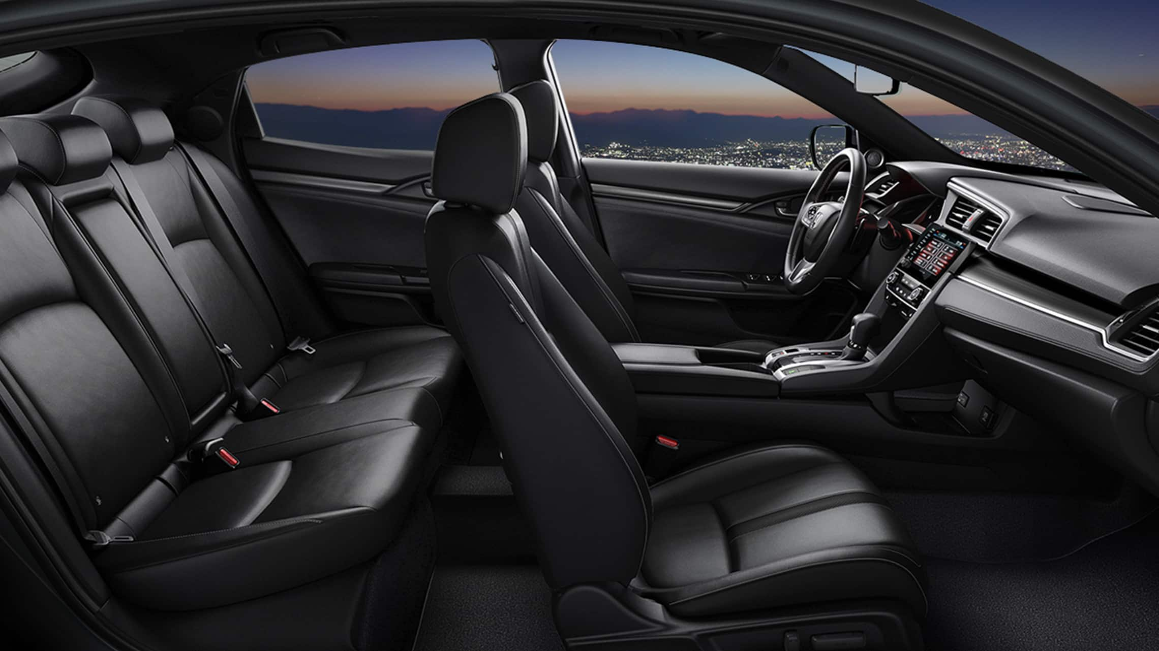 Passenger-side interior profile view of 2020 Honda Civic Sport Touring Hatchback with Black Leather.