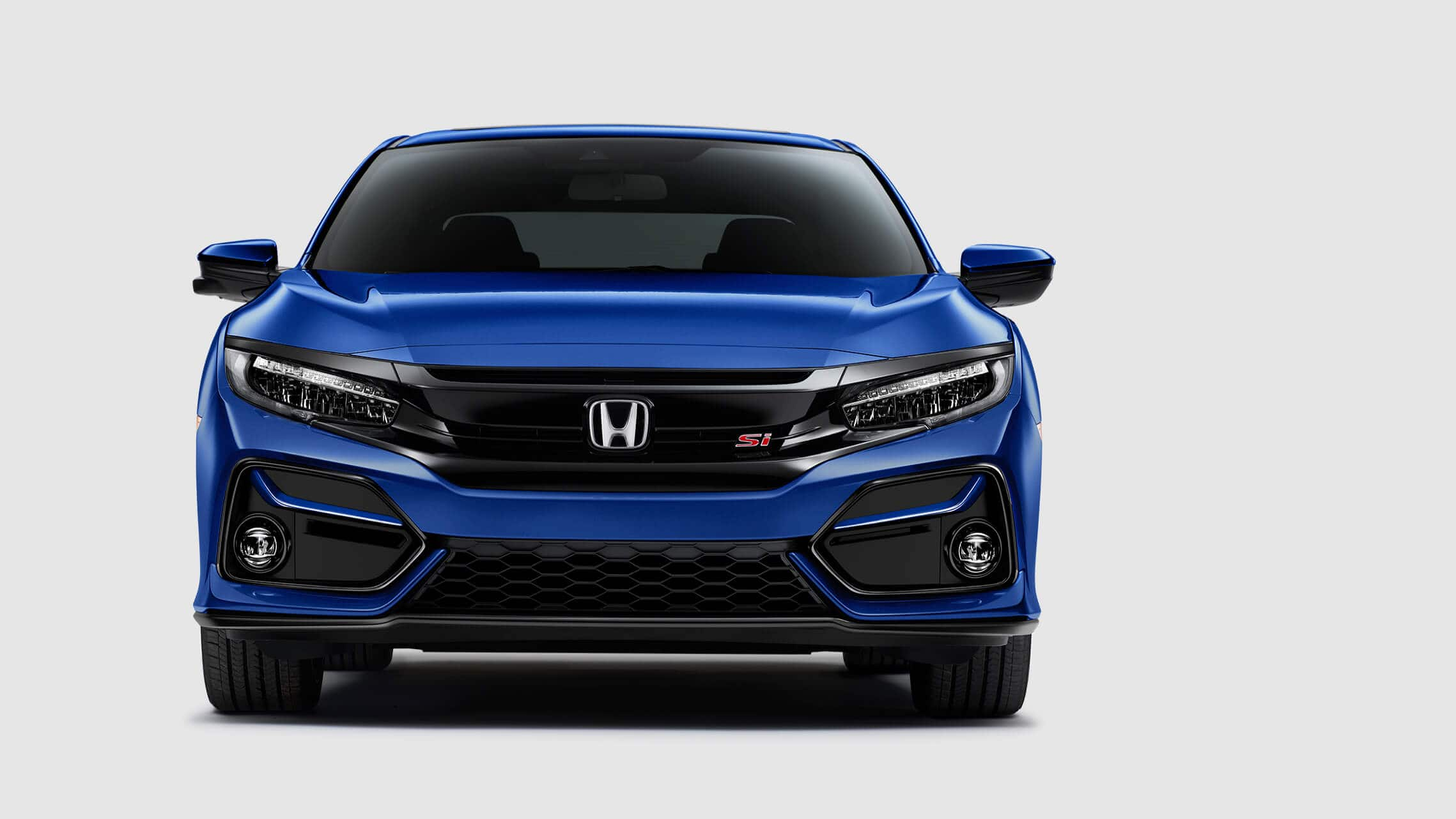 Vista frontal del Honda Civic Si Sedán2020 en Aegean Blue Metallic.