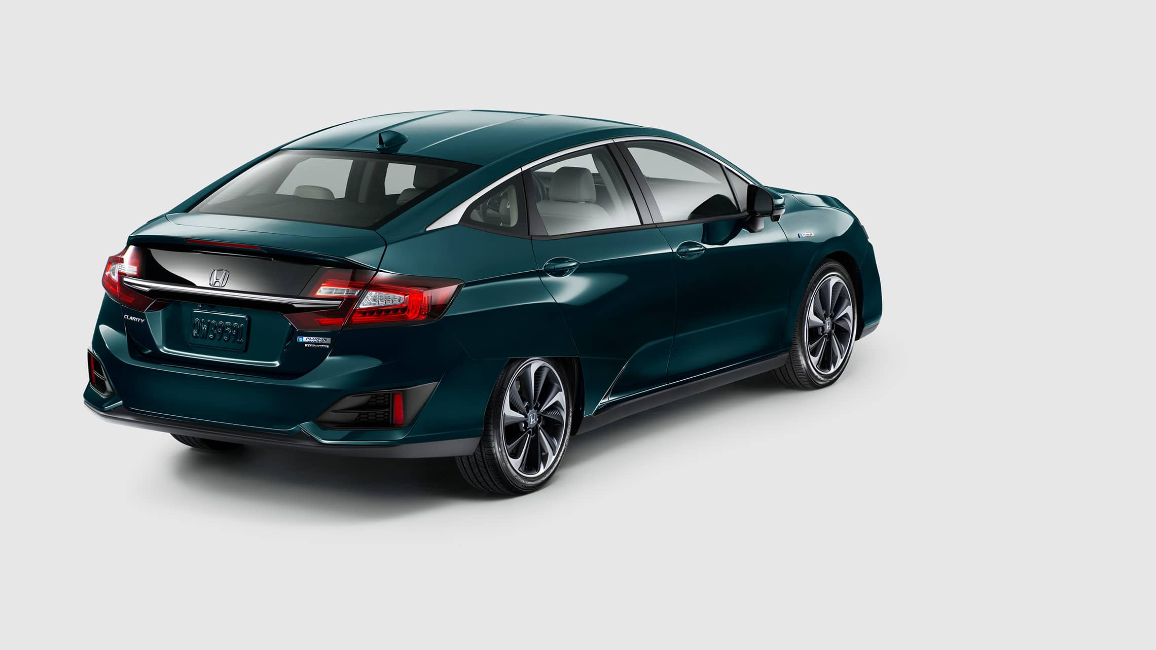 Rear view of 2020 Clarity Plug-In Hybrid in Moonlit Forest Pearl.