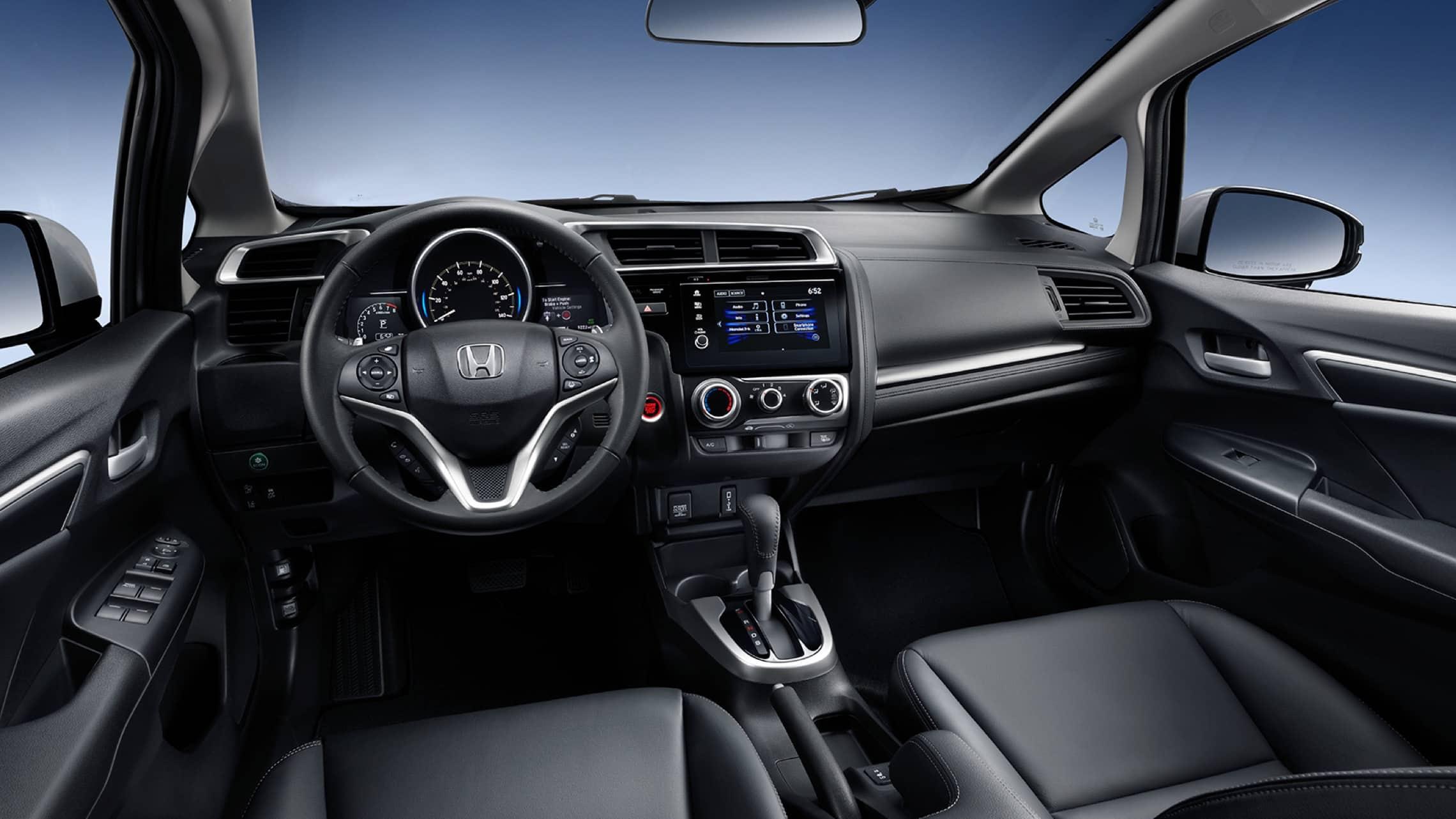 Detalle del volante tapizado en cuero del Honda Fit EX-L2020 en Black Leather.