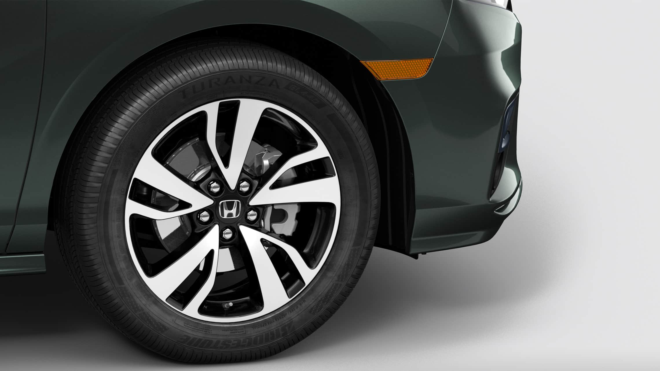 19-inch alloy wheel detail on 2020 Honda Odyssey Elite in Forest Mist Metallic.